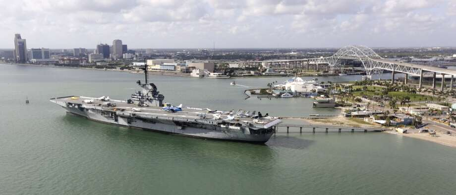 The USS Lexington sits in front of the Harbor Bridge and Port Corpus Christi. Photo: Bob Owen, San Antonio Express-News