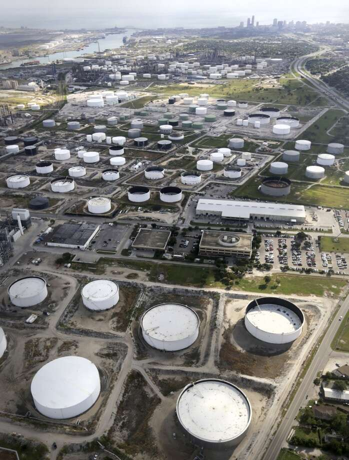 Oil storage tanks stand next to Port Corpus Christi. Photo: San Antonio Express-News