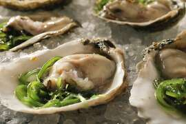 Oysters With Seaweed Salad & Mignonette as seen in San Francisco, California, on Wednesday October 23, 2013. Food styled by Lynne Bennett.