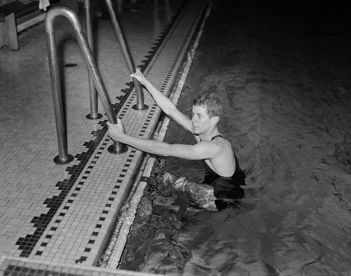 John F. Kennedy, son of Joseph Kennedy, US ambassador to Great Britain, leaves the pool at Harvard University March 10, 1938. Kennedy, shown after practice, swims in the backstroke event for the varsity swimming team at Harvard, where he is a student.