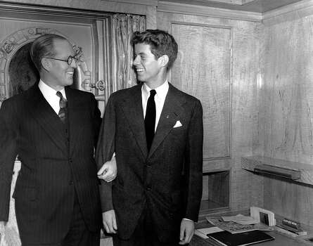 "Joseph P. Kennedy, left, U.S. Ambassador to Great Britain, stands with his son, John F. Kennedy, in New York. Kennedy, was the second son, and one of nine children, of tycoon Joseph P. Kennedy. When first son Joseph Jr. was killed during World War II, Jack became the designated heir. Himself a Navy veteran and survivor of a collision with a Japanese destroyer, he would write to his friend Paul Fay that, once the war was over, ""I'll be back here with Dad trying to parlay a lost PT boat and a bad back into a political advantage."" Photo: Uncredited, ASSOCIATED PRESS / AP1938"