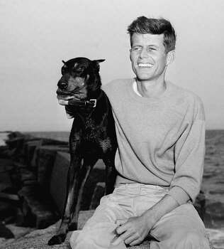John F. Kennedy, winner of the Democratic Nomination for Congress in the 11th Massachusetts District, relaxes with his dog, Mo, June 22, 1946, Hyannisport, Mass. Photo: Peter J. Carroll, ASSOCIATED PRESS / AP1966