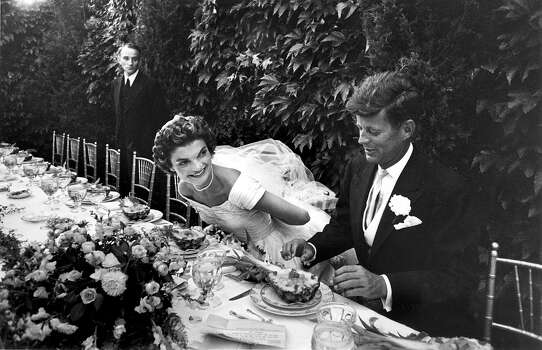 Sen. John Kennedy and his bride Jacqueline in their wedding attire, as they sit down together at table to begin eating a pineapple salad at formally set table outdoors at their wedding reception. Photo: Lisa Larsen, Time & Life Pictures/Getty Image / Time Life Pictures
