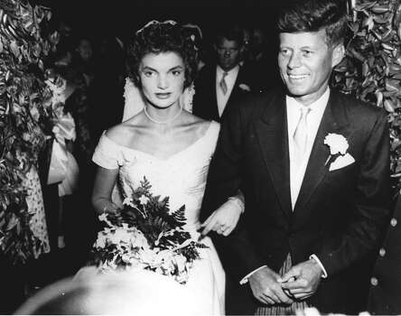 Sen. John F. Kennedy and his bride, the former Jacqueline Lee Bouvier, leave St. Mary's Catholic Church following their wedding in Newport, RI, September 12, 1953.  Archbishop Richard J. Cushing of Boston officiated at the ceremony. Photo: ASSOCIATED PRESS / AP1953