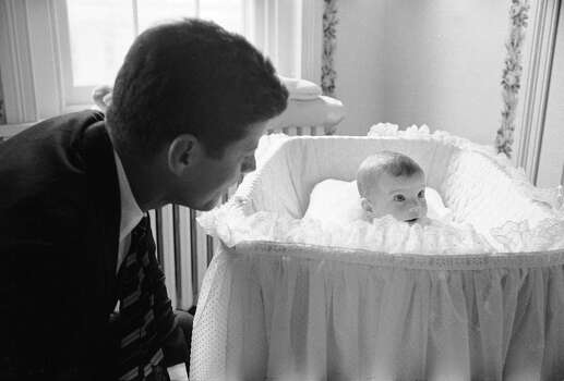 US Senator John F. Kennedy with his baby daughter Caroline in their Georgetown home, Washington D.C. in 1958. Photo: Ed Clark, Time Life Pictures/Getty Images / Time & Life Pictures