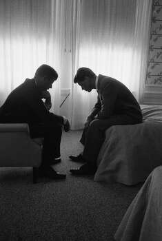 President candidate Jack Kennedy conferring head-to-head with his brother & campaign organizer Bobby Kennedy in 1960. Photo: Hank Walker, Time & Life Pictures/Getty Image / Time & Life Pictures/Getty Images