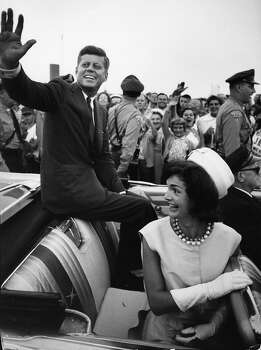 Shortly after his acceptance of the Democratic Party endorsement for President. Senator John F. Kennedy  and his wife, future First Lady Jacqueline Kennedy, smiles and waves from the back of an open-top car, Massachusetts, July 1960. Photo: Paul Schutzer, Time & Life Pictures/Getty Image / Time & Life Pictures