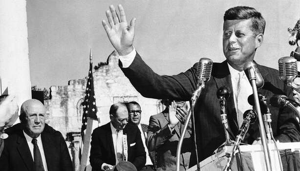 Speaking from a stand in front of the Alamo, Sen. John Kennedy, waves to a crowd of several thousand that jammed the plaza in front of Texas liberty shrine in San Antonio, Texas on Monday, Sept. 12, 1960. Speaker of the House Sam Rayburn is shown at left. Photo: AP / 1960 AP