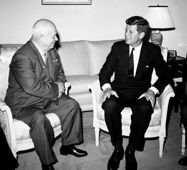 Soviet Premier Nikita Khrushchev and President John F. Kennedy talk in the residence of the U.S. Ambassador in a suburb of Vienna. The meeting was part of  a series of talks during their summit meetings in Vienna in 1961. Photo: Uncredited, AP / 1961 AP