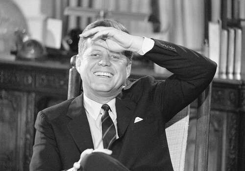 Portrait of American President John F. Kennedy in the White House as he laughs during the filming a televised interview entitled 'After Two Years: A Conversation with the President,' Washington DC, December 16, 1962. Photo: CBS Photo Archive, Getty Images / 2007 CBS WORLDWIDE INC.