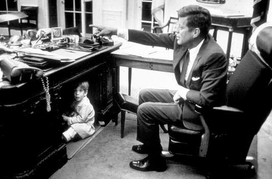 John Kennedy Jr. playing in the Oval Office at the White House, Washington, DC, October 15, 1963. Photo: Getty Images / Hulton Archive