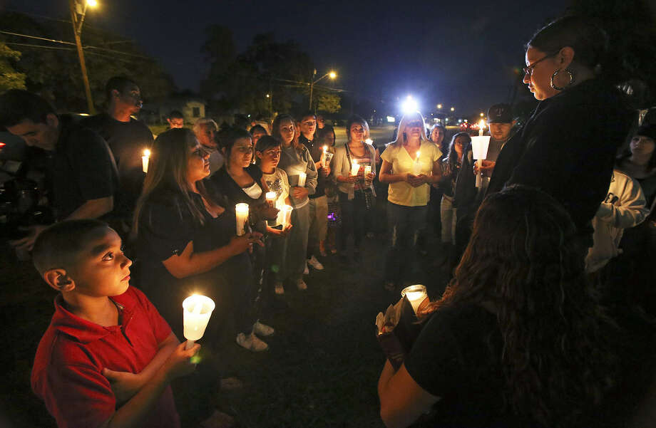 A saddened Priscilla Ledesma talks to supporters in October  during a vigil for her sister Sharon Ledesma who was hit by a car as she crossed Culebra. Photo: Tom Reel / Express-News