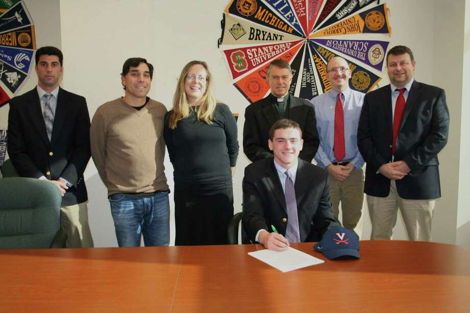 Fairfield Prep's Jake Bowtell of Darien signs his Letter of Intent to dive for the University of Virginia. From left, Tom Curran (Assistant Athletic Director), Joe Somma (Whirlwind Diving, New Canaan YMCA), Jeanine Oburchay (Prep diving coach), John Hanswell, Rick Hutchinson (Prep swim coach) and Steve Donahue (Athletic Director). Photo: Contributed Photo / Darien News
