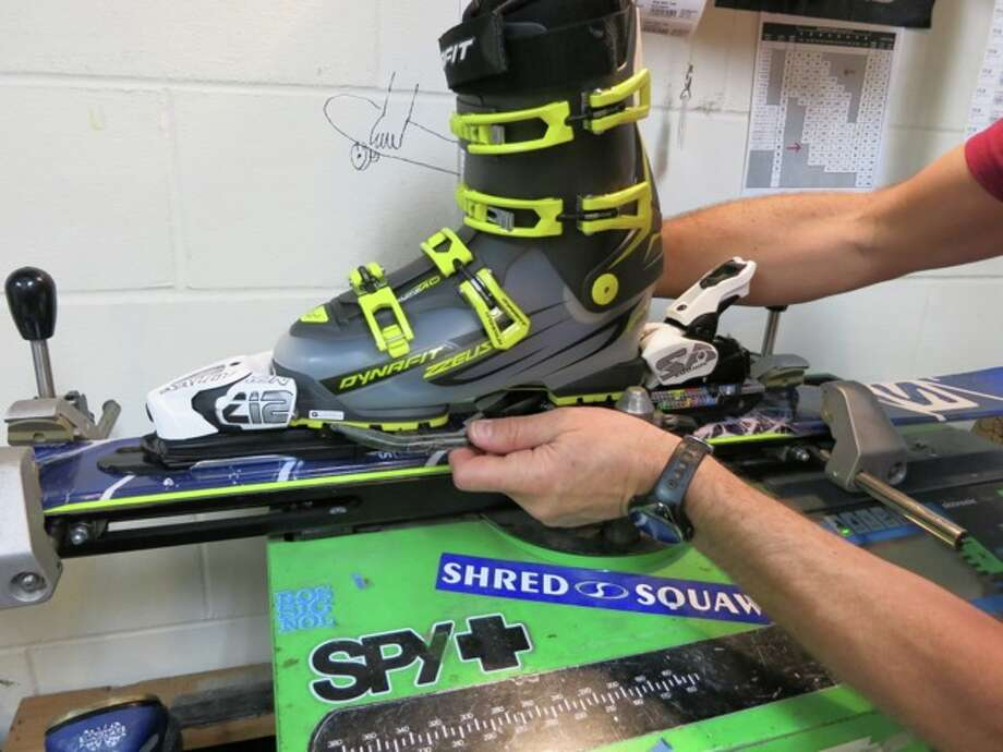 A professional uses the ski binding test machine. Photo: Jules