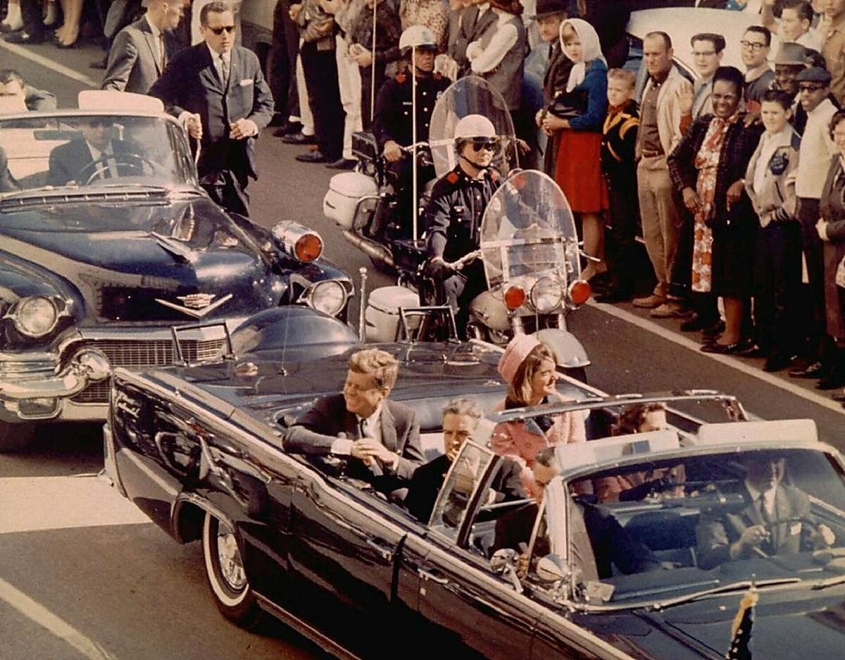 President and Mrs. John F. Kennedy, and Texas Governor John Connally ride through Dallas moments before Kennedy was assassinated, November 22, 1963. REUTERS