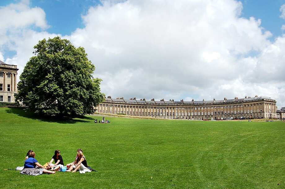 A big, grassy park edges Bath's Royal Crescent, a long, graceful arc of fine Georgian homes where the upper crust lives. Photo: Rick Steves, Rick Steves  Europe
