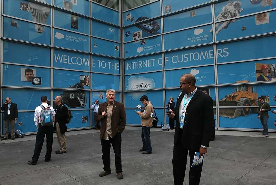 Attendees wait and check messages before the Dreamforce conference opens in San Francisco. Photo: Liz Hafalia, The Chronicle