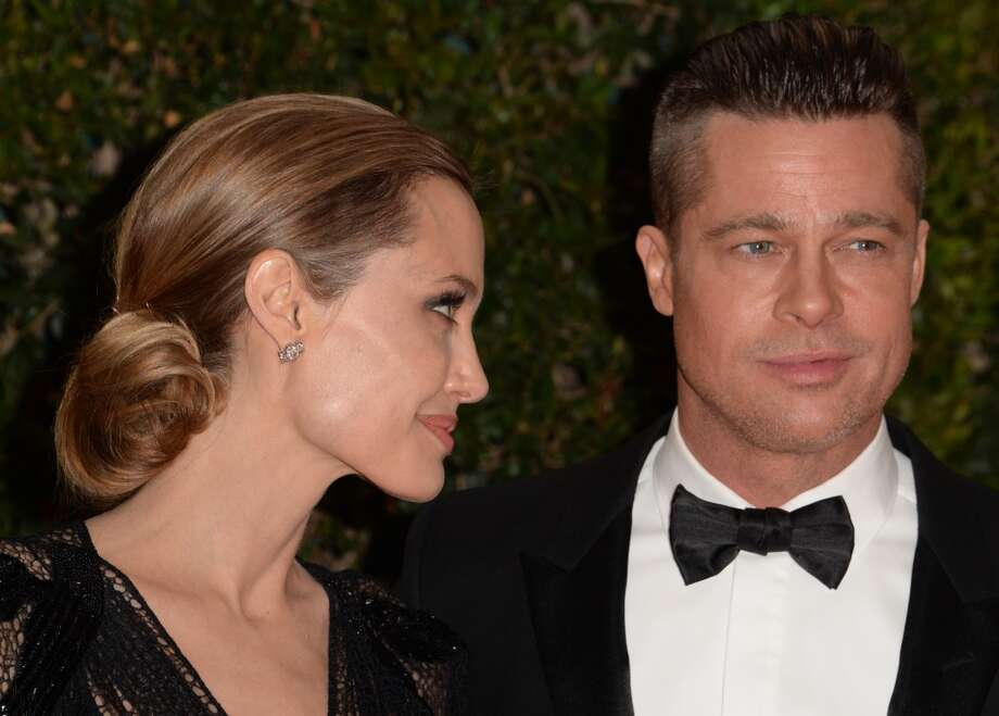 Angelina Jolie and Brad Pitt arrive for the 2013 Governors Awards, presented by the American Academy of Motion Picture Arts and Sciences (AMPAS), at the Grand Ballroom of the Hollywood and Highland Center in Hollywood, California, November 16, 2013. Photo: ROBYN BECK, AFP/Getty Images