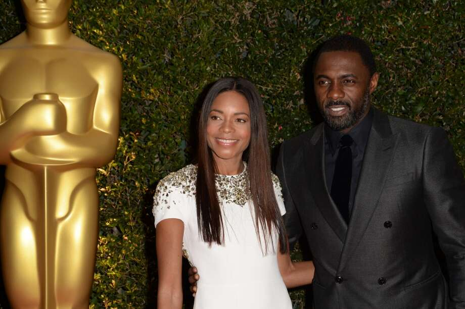 Actress Naomie Harris and actor Idris Elba arrives for the 2013 Governors Awards, presented by the American Academy of Motion Picture Arts and Sciences (AMPAS), at the Grand Ballroom of the Hollywood and Highland Center in Hollywood, California, November 16, 2013. Photo: ROBYN BECK, AFP/Getty Images