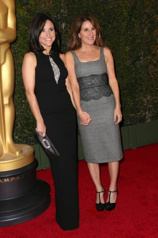Actress Julia Louis-Dreyfus and director Nicole Holofcener arrive at the Academy of Motion Picture Arts and Sciences' Governors Awards at The Ray Dolby Ballroom at Hollywood & Highland Center on November 16, 2013 in Hollywood, California. Photo: Frederick M. Brown, Getty Images