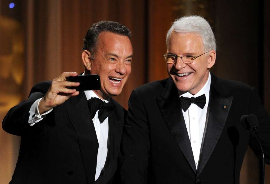 Actor Tom Hanks presents Honoree Steve Martin with honorary award onstage during the Academy of Motion Picture Arts and Sciences' Governors Awards at The Ray Dolby Ballroom at Hollywood & Highland Center on November 16, 2013 in Hollywood, California. Photo: Kevin Winter, Getty Images