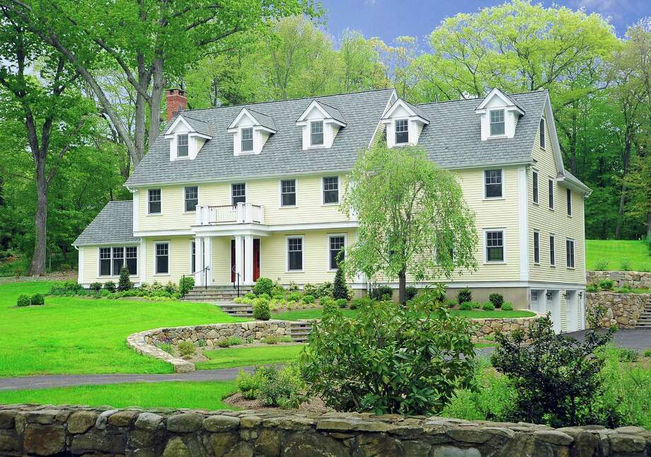 The recently constructed Colonial at 32 Pocconock Trail in New Canaan has sizable grounds on a good road not far from town. It is on the market for $2,350,000. Photo: Contributed Photo, Contributed / New Canaan News Contributed