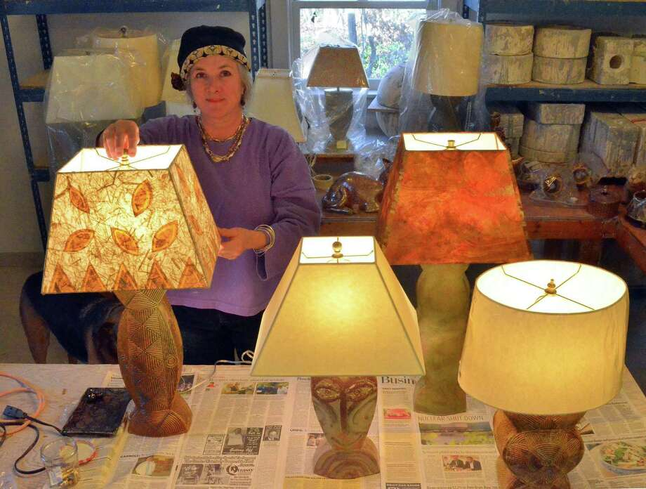 "Kent artisan Alison Palmer is seen here with some of the lamps she's created. Her husband, musician Steve Katz, is a founding member of Blood, Sweat & Tears (""You've Made Me So Very Happy,"" ""Spinning Wheel""), and will perform next month when she has her annual holiday show. Photo: Contributed Photo / The News-Times Contributed"