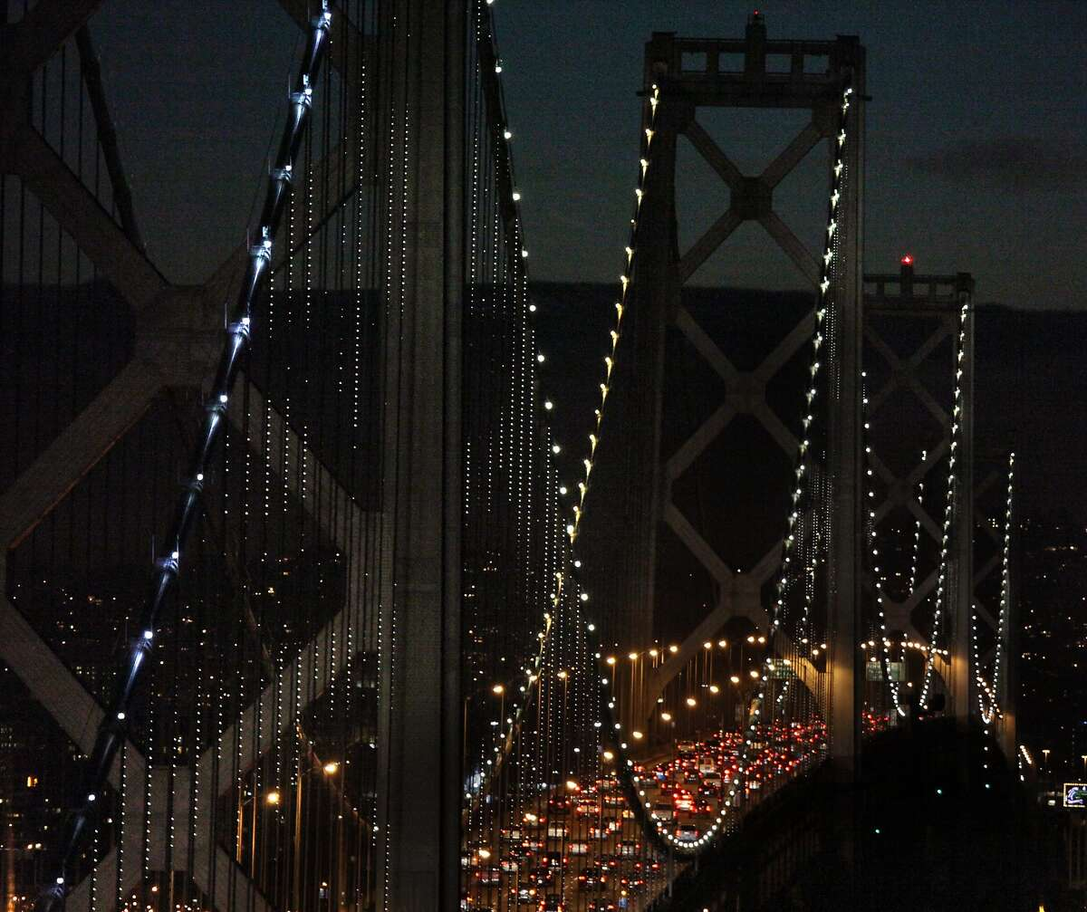 The Bay Lights seen from Yerba Buena island in San Francisco, California, on Friday, November 15, 2013. The Bay Bridge will host the light sculpture, designed by artist Leo Villareal until March of 2015.