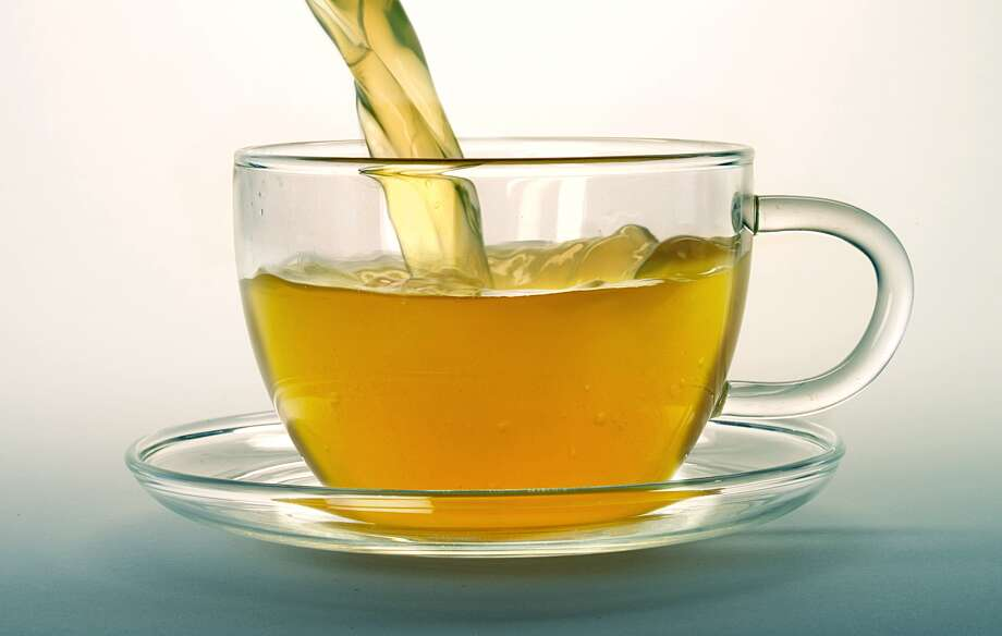 4. Green Tea   The slimming ingredient isn't caffeine. Antioxidants called catechins are what help speed metabolism and fat burning. In a recent Japanese study, 35 men who drank a bottle of oolong tea mixed with green tea catechins lost weight, boosted their metabolism, and had a significant drop in their body mass index. Health bonus: The participants also lowered their (bad) LDL cholesterol.   Reprinted with Permission of Hearst Communications, Inc. Originally Published: 15 Foods to Help You Lose Weight Photo: Photographers Choice Via Getty Images