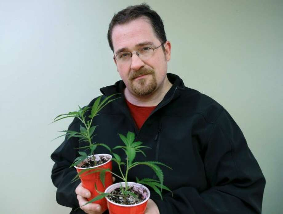 "Paul Schrag holds two cloned plants that will be used to grow medical marijuana Wednesday, Nov. 13, 2013, in Tacoma, Wash. Schrag has a simple philosophy: He hopes to use his skills to do the most good in the world.   For a while, that meant working in journalism, enticed by its power to shape public discourse. Before being laid off in 2009, he worked as a reporter for the Business Examiner, a biweekly publication in Tacoma.   Nowadays, it means working in the pot industry. The 40-year-old says he's been growing marijuana since 1999 and uses it to treat lifelong neck pain. He began working at a medical marijuana collective, where part of his job entails coming up with a marketing and public education plan to help erase any stigma associated with cannabis use. He believes the medical and social benefits of the plant are only just starting to be understood.   He plans to work as a grower's vice president of marketing, research and development, and believes his knowledge of pot and business will help.   ""I'm one of those rare cats that get both,"" he says. Photo: Ted S. Warren, Associated Press"