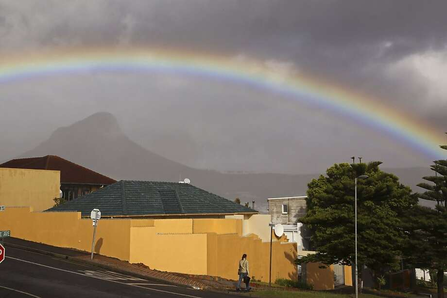 A rainbow arcs over Cape Town, South Africa, after a heavy rain. Photo: Schalk Van Zuydam, Associated Press