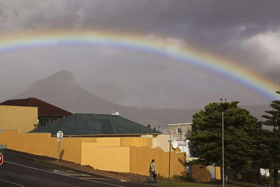 A rainbow arcsover Cape Town, South Africa, after a heavy rain. Photo: Schalk Van Zuydam, Associated Press