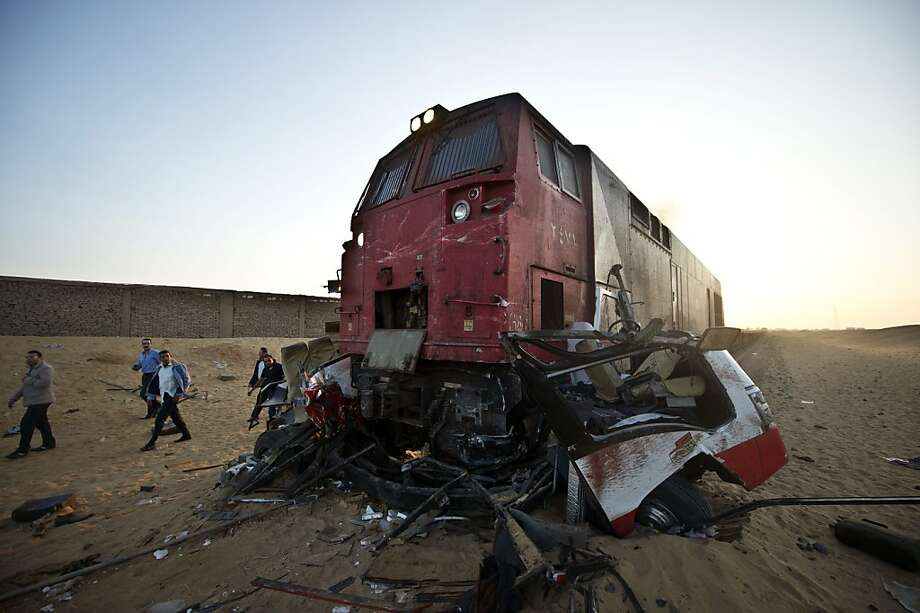 Deadly miscalculation: At least 26 people were killed and another 28 injured when a mini-bus and a truck unsuccessfully tried to cross 