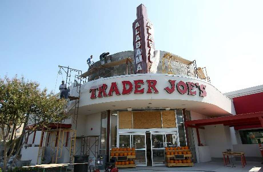 Workers put finishing touches on the Trader Joe's Montrose location, which opened in September of 2012. Photo: Karen Warren, Houston Chronicle