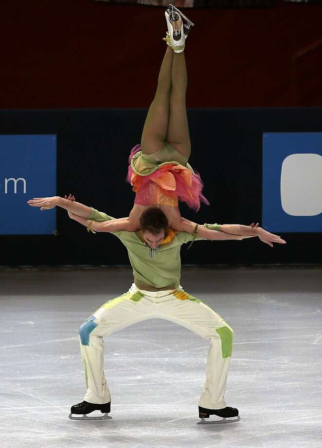 Losing her head: France's Fabian Bourzat assists in the decapitation of partner Nathalie Pechalat during the free dance event at 