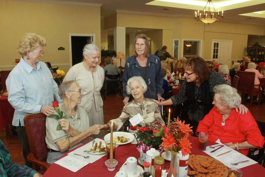 Family and friends joined a recent special occasion at The Abbey at Westminster Plaza as Bob and Evelyn Davis (seated, left and center), celebrated their 12th anniversary. Joining them were, from left,  Barbara Cook, Diana Kelso (Evelyn's daughter), Kathy Lankford, Nancy Gachman and Hermarae Messina. -- Gary Fountain photo Photo: Gary Fountain / Copyright 2013 Gary Fountain.