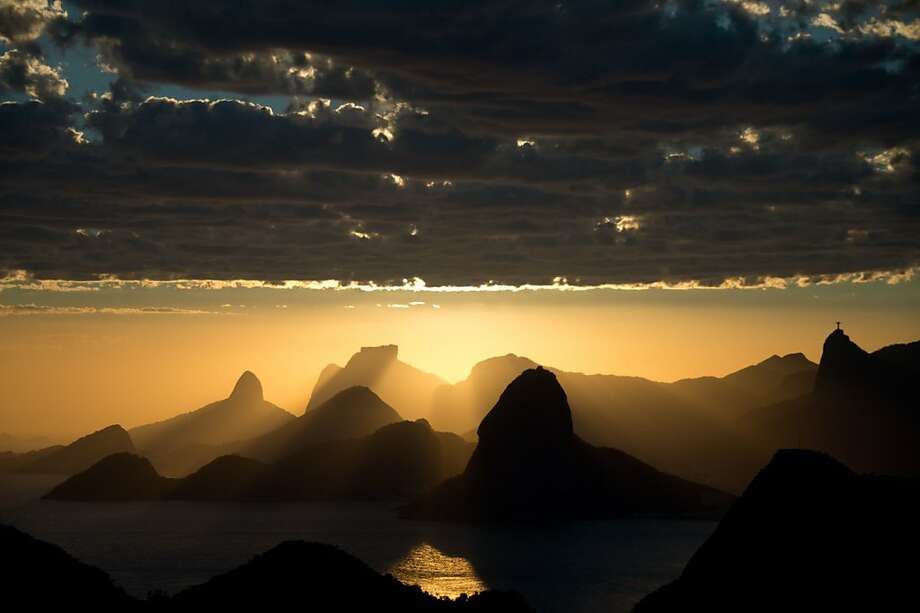 The coolest sunset in the world over the weekend just might have been this one in Rio de Janeiro. Photo: Christophe Simon, AFP/Getty Images