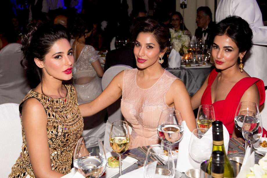 Nargis Fakhri, Sophie Chaudhary and Sonal Chauhan attend the inaugural amfAR India event at the Taj Mahal Palace Mumbai on November 17, 2013 in Mumbai, India. Photo: Kevin Tachman, Getty Images