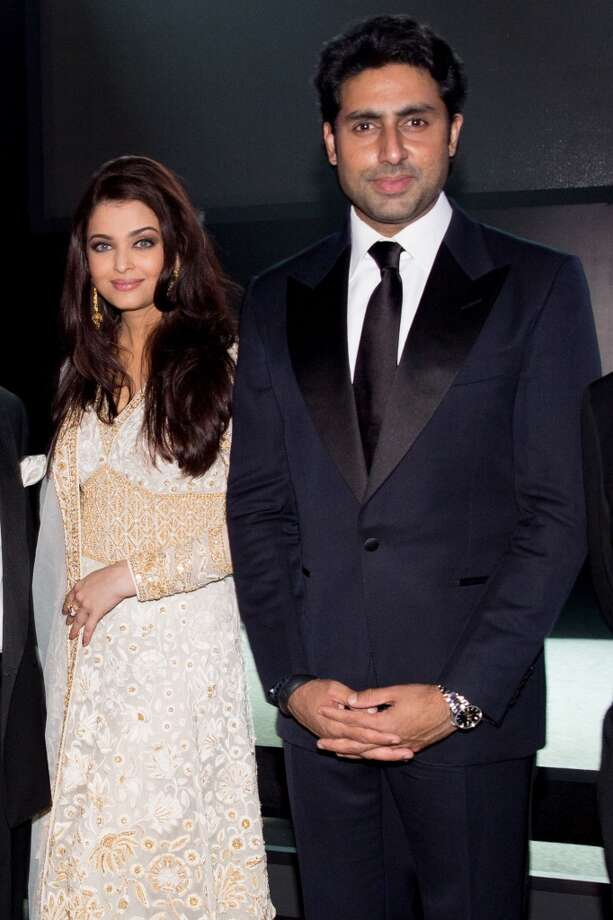Aishwariya Rai Bachchan and Abhishek Bachchan attend the inaugural amfAR India event at the Taj Mahal Palace Mumbai on November 17, 2013 in Mumbai, India. Photo: Kevin Tachman, Getty Images