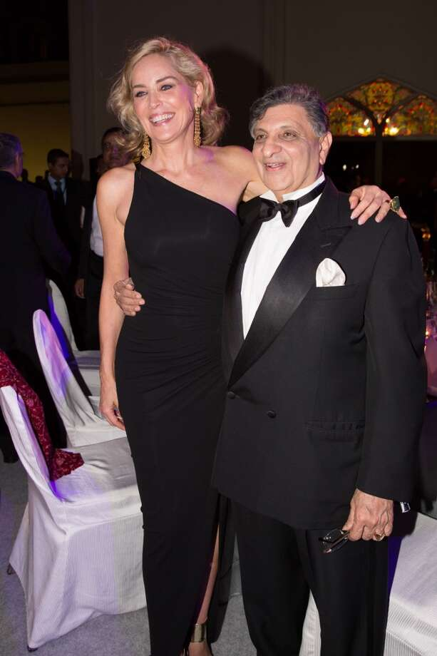 Sharon Stone and Cyrus Poonawalla attend the inaugural amfAR India event at the Taj Mahal Palace Mumbai on November 17, 2013 in Mumbai, India. Photo: Kevin Tachman, Getty Images
