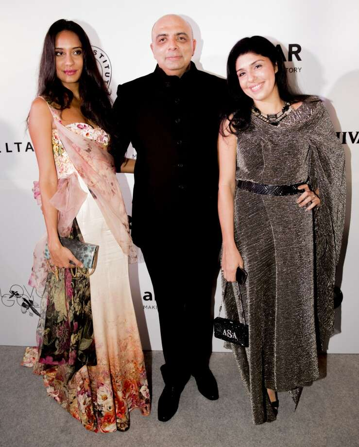 Lisa Haydon, Tarun Tahiliani and Anaita Adjania Shroff attend the inaugural amfAR India event at the Taj Mahal Palace Mumbai on November 17, 2013 in Mumbai, India. Photo: Kevin Tachman, Getty Images