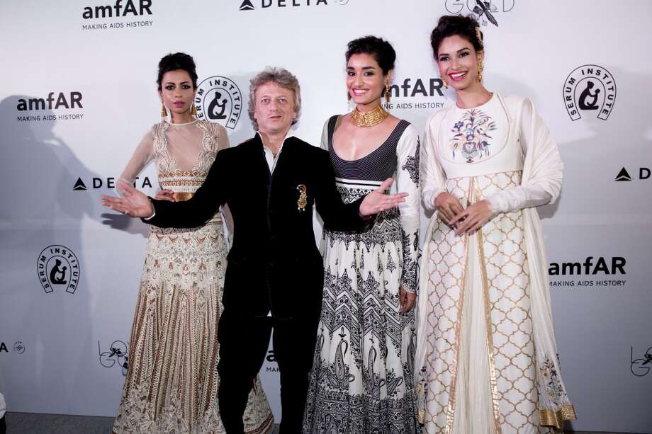 Sapna Kumar, Rohit Bal and Kanistha Dhankar attend the inaugural amfAR India event at the Taj Mahal Palace Mumbai on November 17, 2013 in Mumbai, India. Photo: Kevin Tachman, Getty Images