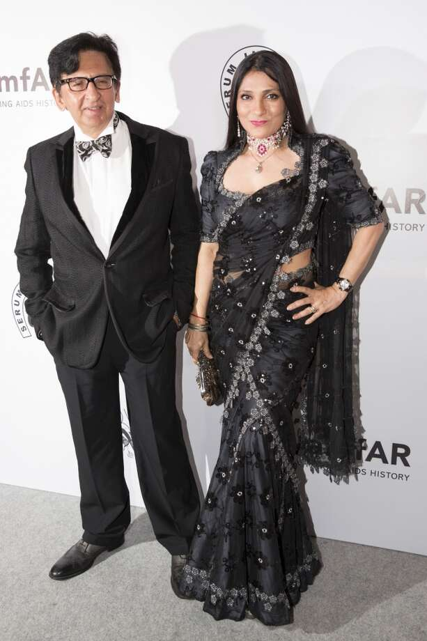 Kailash Surendranath and Aarti Surendranath attend the inaugural amfAR India event at the Taj Mahal Palace Mumbai on November 17, 2013 in Mumbai, India. Photo: Kevin Tachman, Getty Images