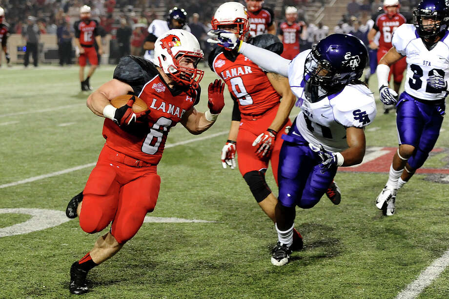 Lamar Cardinal's Kade Harrington, 8, runs for a short gain against the Stephen F. Austin Lumberjacks at Provost Umphrey Stadium Saturday night. Photo by Drew Loker. Photo: D / ©2013. www.drewloker.com