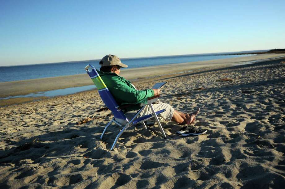 It felt like summer as Rachel Jensen spends the late afternoon reading her paper at Greenwich Point Beach in Greenwich, Conn. on Monday, Nov. 18, 2013. The high temperature for the day was in the mid-60's. Tomorrow's weather is expected to be quite a bit cooler, in the mid-40's. Photo: Cathy Zuraw / Greenwich Time