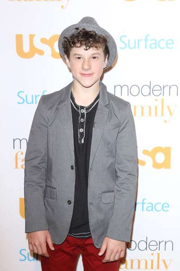 "Nolan Gould plays Nick Dunphy on ABC's ""Modern Family."" Get this: this lil' genius is a member of MENSA. Photo: Michael Tran, FilmMagic / 2013 Michael Tran"