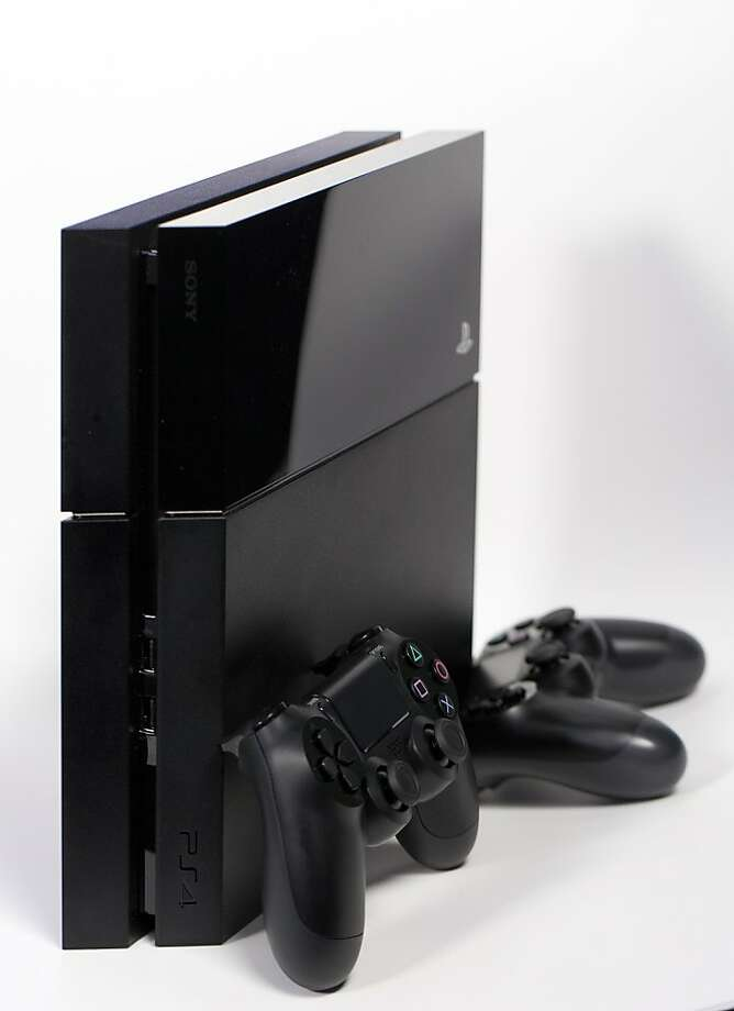 A Sony PlayStation 4 (PS4) games console and controller. A man was shot multiple times Sunday in San Francisco when he and the supposed buyer had agreed to meet to exchange a  Playstation 4. Photo: Simon Dawson, Bloomberg