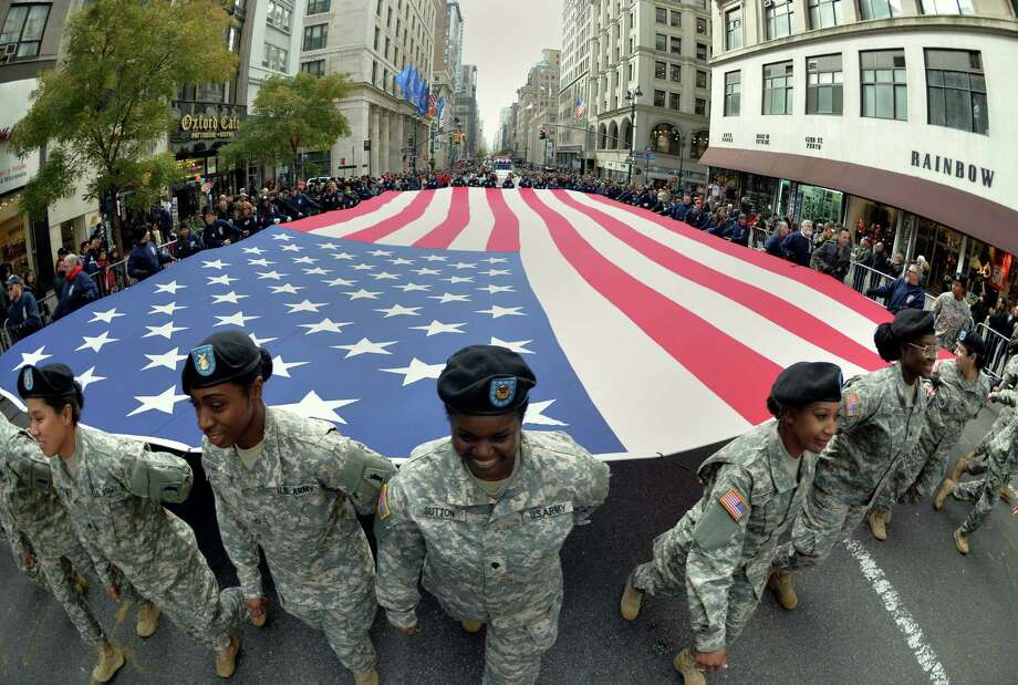 Members of the New York State National Guard  march in the annual Veterans Day parade in New York. Take time to talk with veterans. Photo: Stan Honda / Getty Images