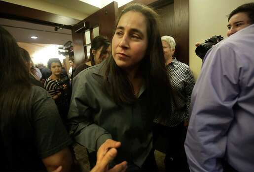 A teary eyed Anna Vasquez is greeted by well wishers as she leaves the 175th District Court where family and friends of Elizabeth Ramirez, Cassandra Rivera and Kristie Mayhugh gathered in the Cadena Reeves Justice Center to hear that the 3 women  were released from prison. Monday, Nov. 18, 2013. Anna Vasquez, was released on parole from prison just over a year ago. Photo: Bob Owen, San Antonio Express-News / ©2013 San Antonio Express-News