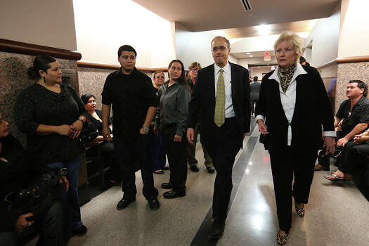 Bexar County District Attorney Susan Reed, right, and First Assistant District Attorney Cliff Herberg, Jr, arrives before the start of the San Antonio Four hearing in the Bexar County District Court 175th, Monday, Nov. 18, 2013. Later, bond was set clearing the way for the last three of four women sentenced for sexual assault of a child to be released from prison. The woman looking at Herberg and standing to his right is Anna Vasquez who was the fourth person convicted and released on parole last year. The four women convicted in the 1994 sexual assault case are Cassandra Rivera, Elizabeth Ramirez, Kristie Mayhugh and Anna Vasquez, in grey pant and black shirt right of Herberg. On the left of Vasquez is Mike Rivera, son of Cassandra Rivera. Photo: Jerry Lara, San Antonio Express-News / ©2013 San Antonio Express-News